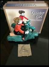 Scooter girl tin lithographed wind