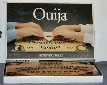 Mystifying oracle talking board set
