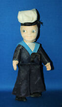 A style sailor boy doll dressed