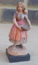 Small carved wood figurine of girl