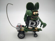 Rat fink skateboard sidewalk surfer