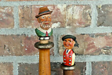 2 hand carved wood bottle stoppers