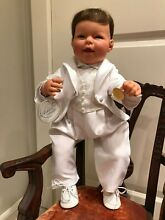 Collectible artist doll ring bearer