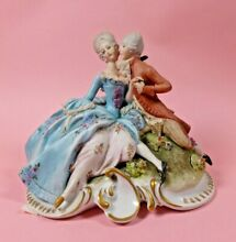 Figure of courting lady gentleman