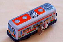 Japan tin toy new lithographed wind