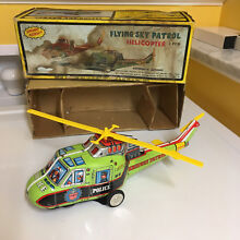 Tin flying sky patrol helicopter w