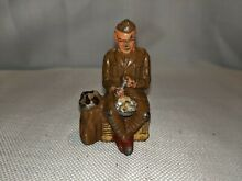 Manoil toy lead seated soldier