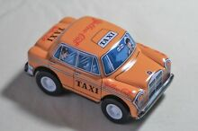 New tin toy 3 friction metal yellow