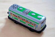 New tin toy lithographed 4 wind up