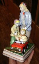 Mother woman and children toy car