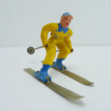 Lead toy man on skis in yellow