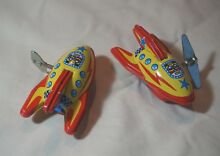 Two tin toy 3 wind up auto turn