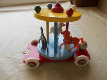 Wooden pull toy carousel w 3