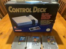 Boxed game console plus 3 games 80s