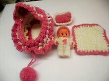 Vinyl winged doll in a hand knit