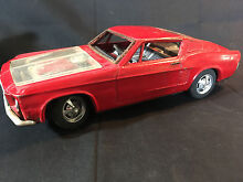 Old red ford mustang tin toy car