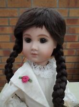 Dolls wig in dark brown plaits and