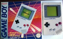 Grey handheld system boxed games