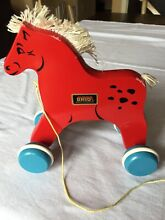 Wooden red horse pull toy from the
