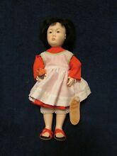 Chinese orange blossom doll by