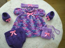 Hand knitted dolls clothes to fit