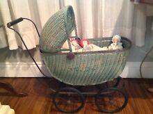 Green wicker doll buggy stroller