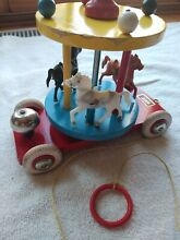 Carousel pull toy bell horses