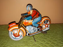G e 255 tin toy wind up motorcycle