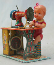 1950 s tin wind up sewing machine
