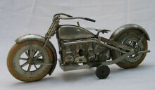 Early tin wind up motorcycle toy