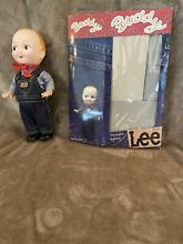 Doll overalls and bandanna box in