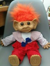 Large doll troll orange hair in a