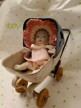 Baby doll in buggy carriage 1930