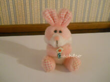 Pink bunny rabbit holding flower