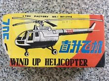 Rare s helicopter 705 wind up tin