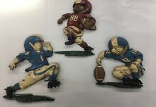 3 1976 football player plaques wall