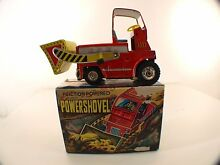 Friction powered tin toy