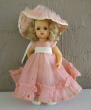 1950 s tiny walker in pretty outfit