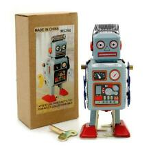 Tin toy robot 4 5 wind up blue