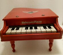 Baby gran piano red color in