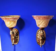 Pair Of Brass Wall Sconces with Ornate Swirl Pattern Glass Lamp Shades