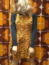Run & FLY 80's/90's style dungaree dress in denim with Dinosaur print in mustard