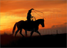 Reproduction sur toile Cowboy with horse at sunset - Joe Restuccia III