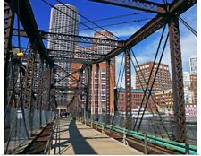 Poster Print Wall Art entitled Iron footbridge with Boston Financial district in