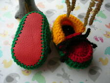 Baby booties. Rasta. Hand crocheted by myself. Red real leather soles. 4 sizes.