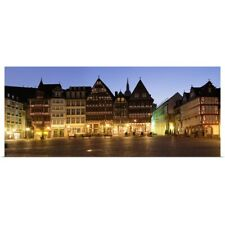 Poster Print Wall Art entitled Half-timbered houses on the hill lit up at dusk,