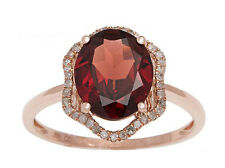 Rose Gold 3.20ct Oval Garnet and Halo Pave Diamond Ring