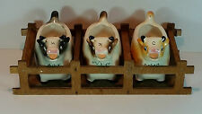 VINTAGE RETRO HAND PAINTED 3 COW CREAMER & MILK JUGS IN WOODEN STALL STAND