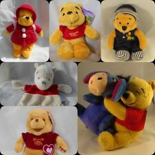 selection of Disney winnie the pooh soft toys
