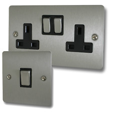 Flat Brushed Steel Sockets and Switches with Black Inserts and Matching Switches